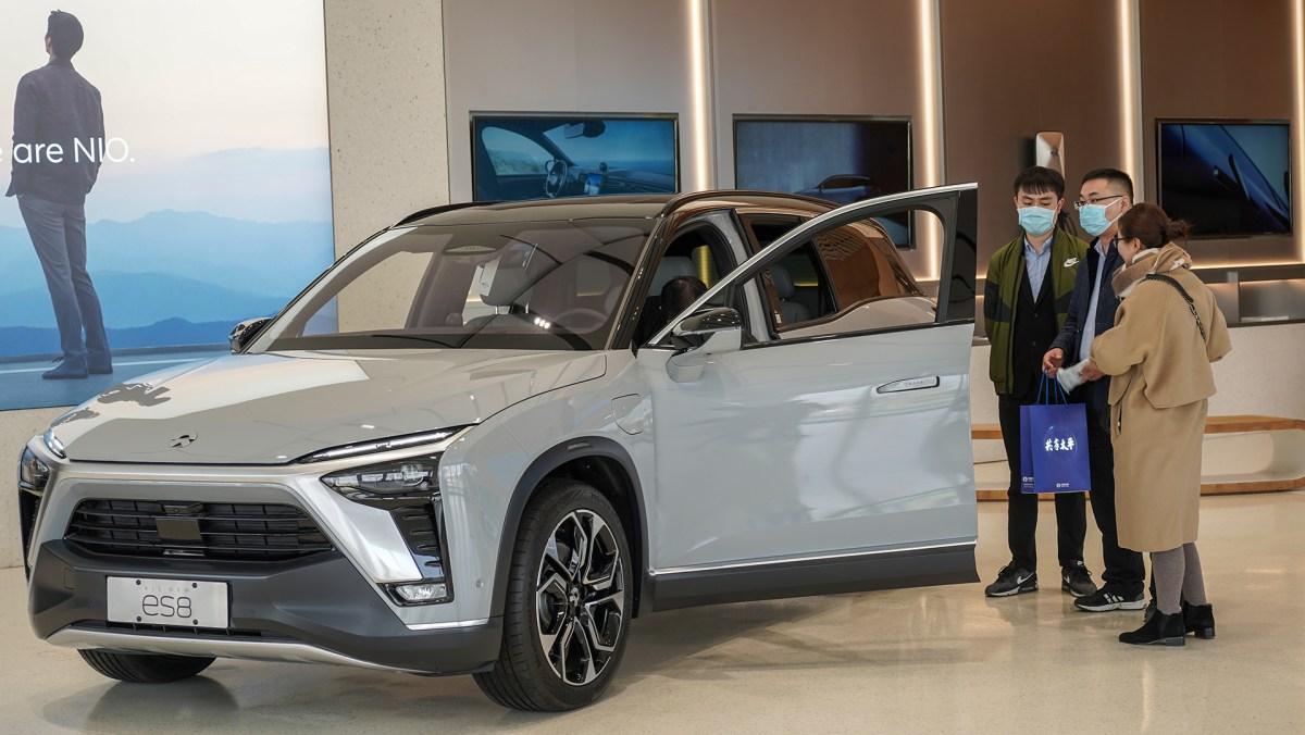 EV Nio electric vehicles Tesla Xpeng Hefei