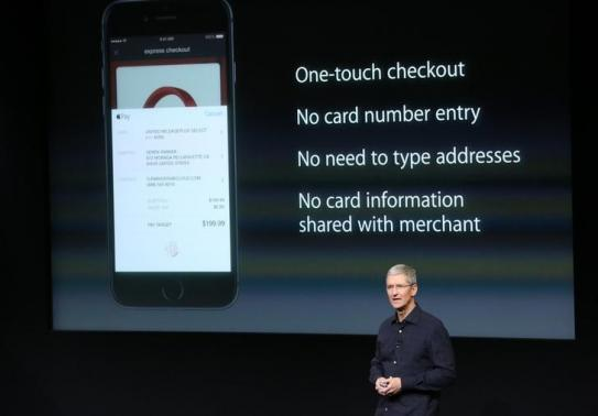 Apple CEO Tim Cook speaks about the Apple Pay service during a presentation at Apple headquarters in Cupertino