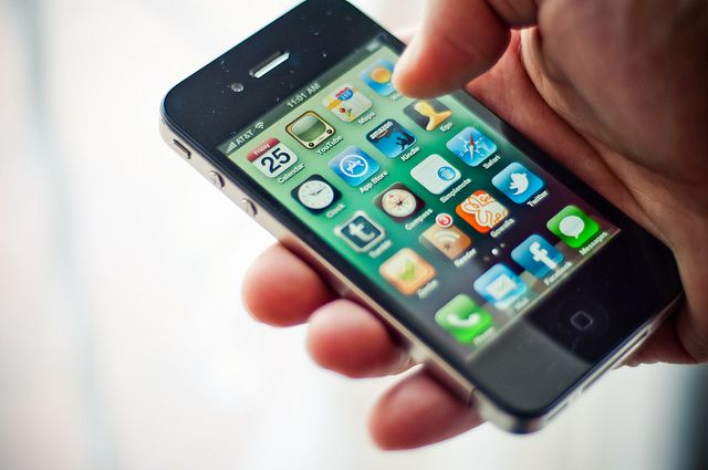 The Apple iPhone 4 showing apps