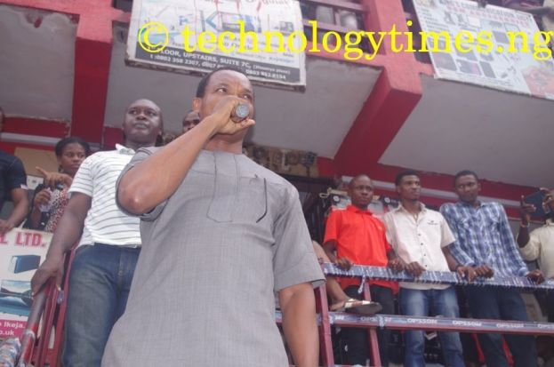 Iyke Nwosu, President of PAPDAN, seen adressing the protesters_on Monday. Phone dealers at Ikeja Computer Village on Monday said that they have decided to lock their shops for three days in peaceful protest against last Saturday's raid of the market by the Standard Organisation of Nigeria (SON) Photo credit: Technology Times/Kolade Akinola