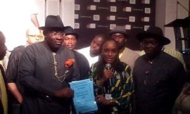 Seriake Dickson, Governor of Bayelsa (keft) and Omobola Johnson, Minister of Communication Technology, display the MoU signed to select Bayelsa as one of the Smart States in Nigeria