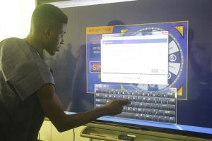 Participant playing an online game at Lagos Social week