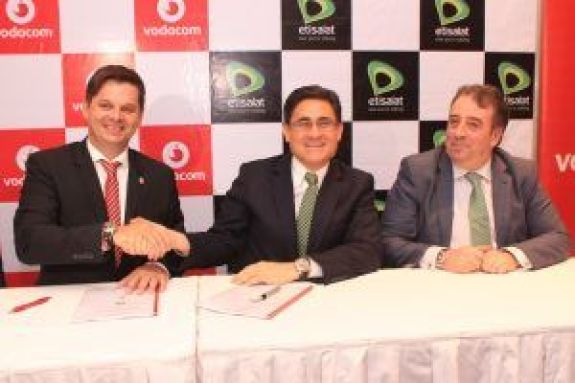 Managing Director, Vodacom Business Nigeria, Mr. Guy Clarke(Left) in warm handshake with the Chief Executive Officer, Etisalat Nigeria, Mr. Matthew Willsher(Middle) during the announcement of a partnership by the companies in Lagos