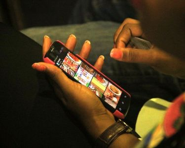 A mobile phone user seen at the 2016 Social Media Week Lagos