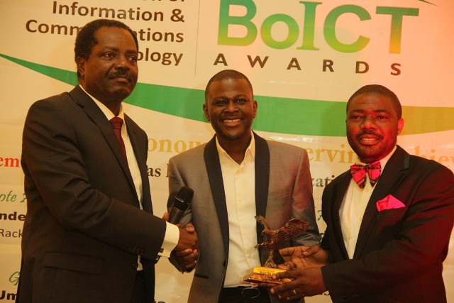 Mr Oluseyi Akindeinde (Middle) receiving the best cyber security company of the year award at the Beacon of Information and communication Technology Awards