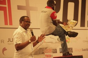 "Tunji Adeyinka, Managing Director of Connect Marketing Limited, organisers of TechPlus 2016 (left), seen speaking with the ""Levitating Man"" in foreground at TechPlus 2015, one of the key attractions at the tech show held at the Eko Hotel & Suites in Lagos"