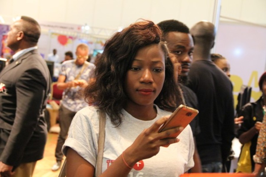 A phone user seen at the Tech+ technology show in Lagos