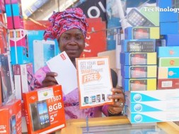 A phone seller seen inside Ikeja Computer Village in Lagos, Nigeria's biggest technology market cluster