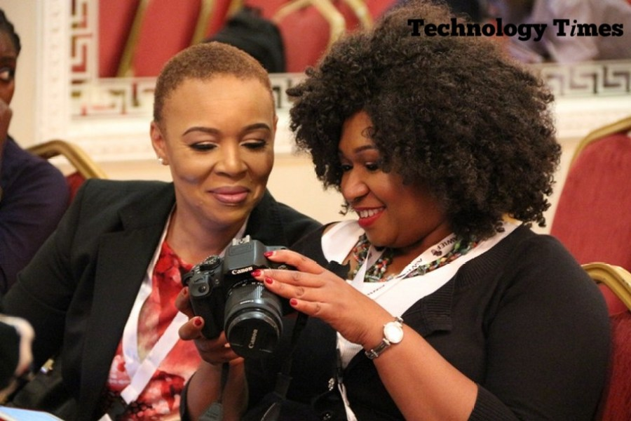 Technology Times photo shows two women looking at a DSLR camera at the Africa Women Innovation and Entrepreneurship Forum (AWIEF 2016) held last week in Lagos.