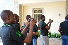 Mobile phone users seen at a tech event in Abuja