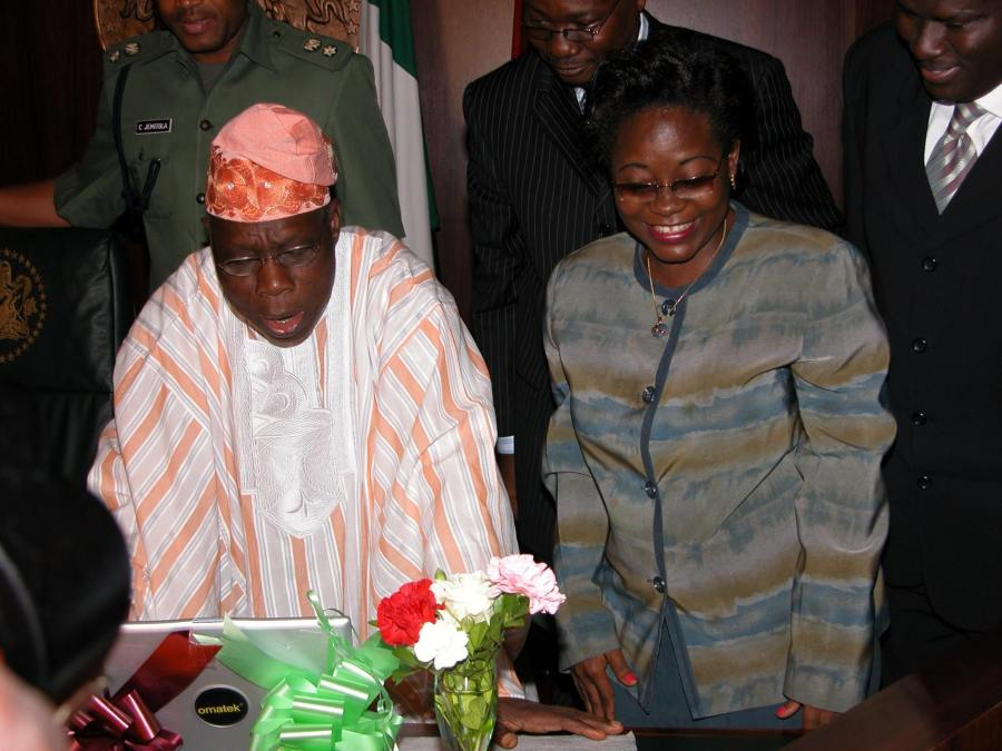 Facebook photo shared by Oluyomi Soyinka, shows Engineer Mrs Florence Omatule Seriki, GMD/CEO. Omatek Computers, on the right, showing the company's laptop computer to then President Olusegun Obasanjo in the Presidential Villa in Abuja