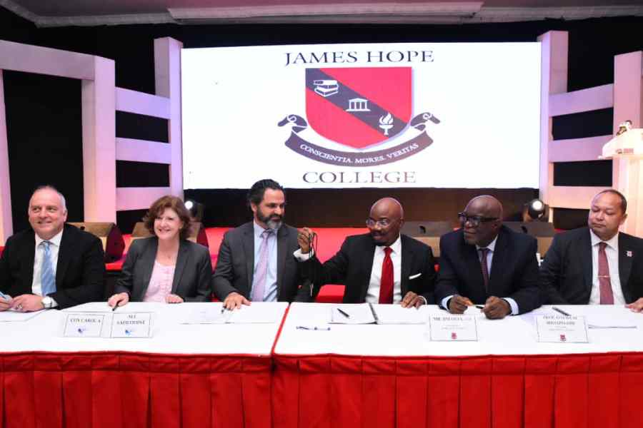 Photo release shows Chairman, Jim Ovia Foundation, Mr. Jim Ovia ( third from right) and other personalities Wednesday at the signing ceremony of the acquisition of American International School Lagos Property to establish James Hope College Lagos held at the Civic Centre, Victoria Island, Lagos.
