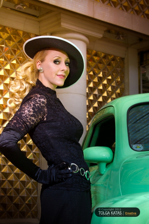 Christine Marie by a classic green car