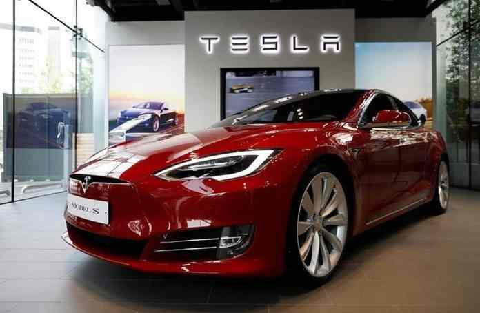 How can Tesla's entry into India affect the Automobile Industry in the country?