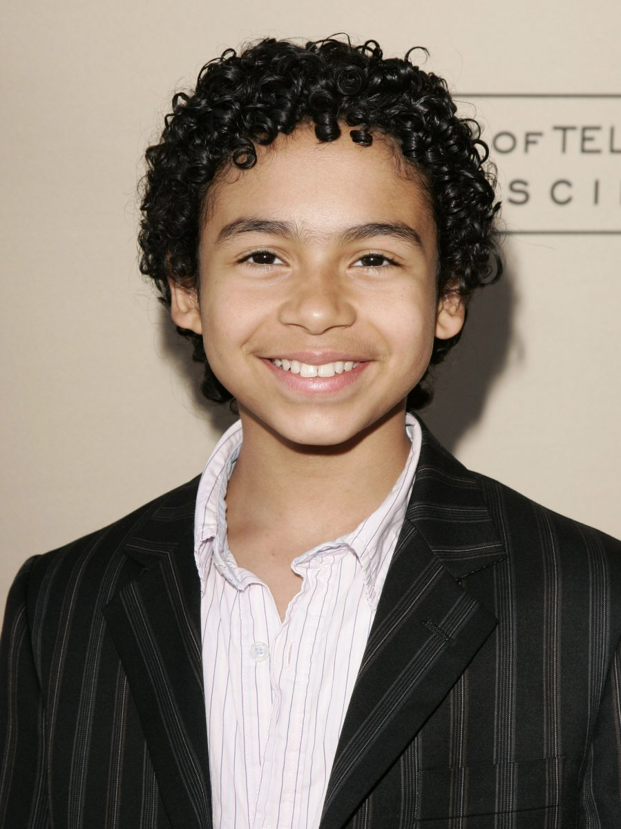 Noah Gray-Cabey wearing a black suit jacket to the 'Heroes' red carpet event.
