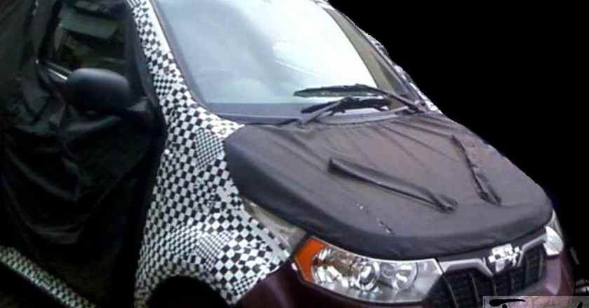 Mahindra e2o 4-door spied up-close.  Reveals front design