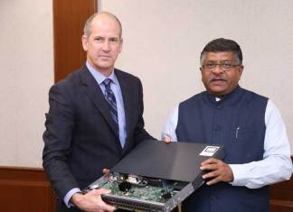 Union minister for electronics and information technology, Ravi Shankar Prasad flanked by John Kern, SVP, supply chain operations, and India executive sponsor, Cisco. (Photo/Cisco)