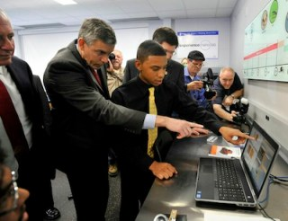 Secretary of Education Arne Duncan gets a lesson in nanotechnology from Wheeling High School student Drakkari Lott. (Photo: Ed.gov)