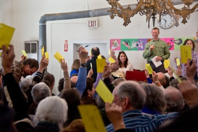 Voting at a town hall meeting in Calais, Vermont (image via Shutterstock)