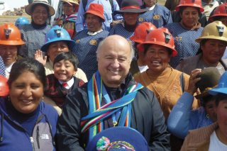 Hernando de Soto with Peruvian miners and their families. (They don't mine Bitcoin, but he thinks the blockchain can help them.)