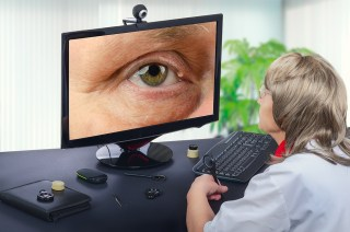 A telemedicine ophthalmologist remotely examines a cyst on someone's eye. (photo courtesy Shutterstock)
