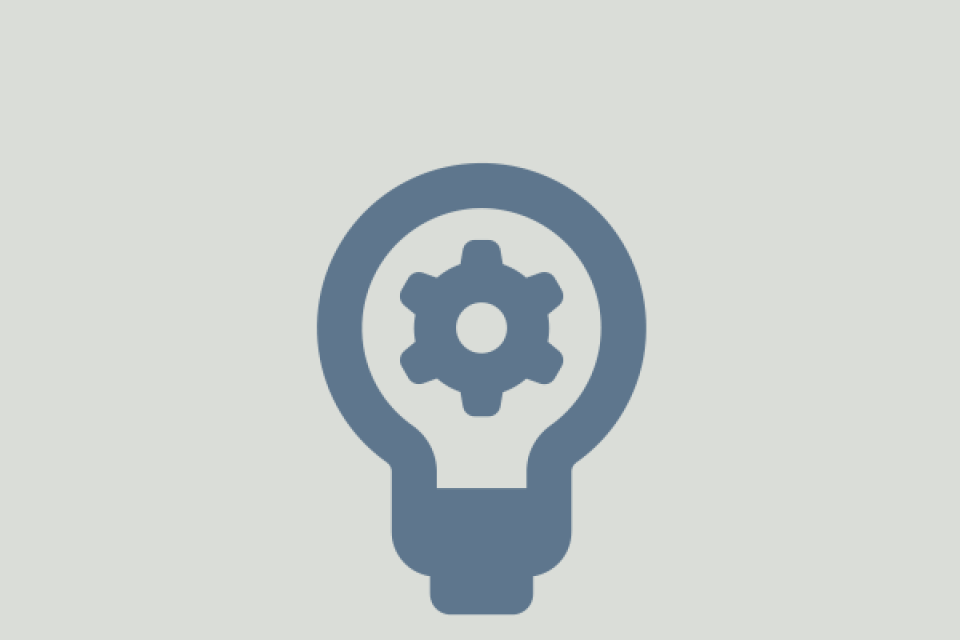 icon of lightbulb with gear inside
