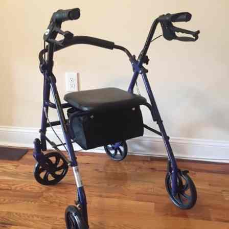 Blue framed wheeled walker with seat