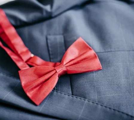 Red bow pinned to a pocket