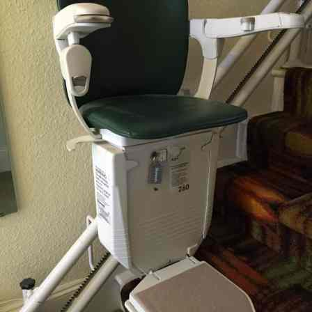 Close up of an unoccupied stairlift chair.