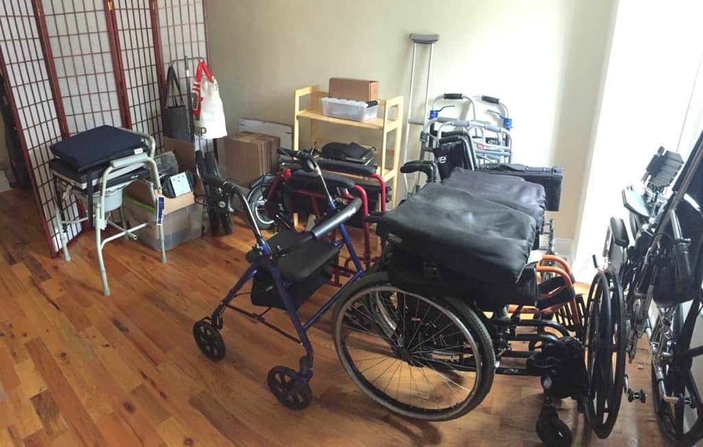 image of several folded wheelchairs, walkers and other devices.