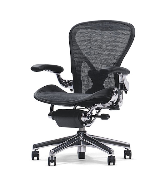 prevent work related back pain with good posture and an ergonomic
