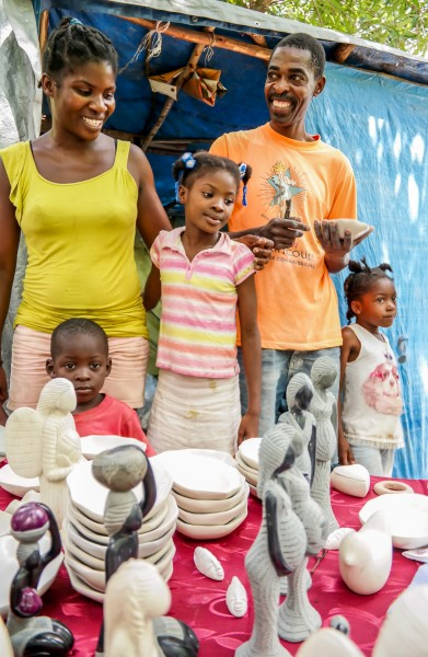 Chena Jilles, soapstone artist in Leogane, Haiti with her Family