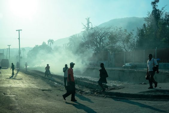 Morning haze plus smoke makes individuals in Port au Prince seem like silhouettes on this January day © 2015, Leticia Barr All Rights Reserved