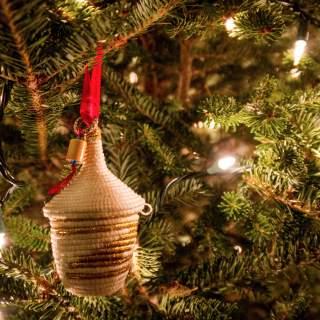 "How Buying Handmade Artisan ""Trade Not Aid"" Ornaments from Haiti & Rwanda Give Hope"