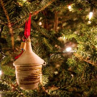 "How Buying Handmade Artisan ""Trade Not Aid"" Ornaments from Haiti & Rwanda Give Hope"