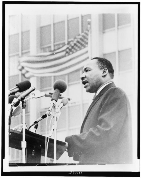 Martin Luther King, Jr., half-length portrait, facing left, speaking at microphones, during anti-war demonstration, New York City / World Journal Tribune photo by Don Rice courtesy of Library of Congress