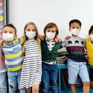 group of elementary kids wearing masks
