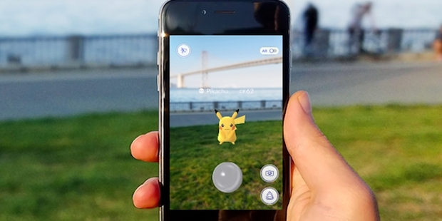 playing pokemon go in the streets
