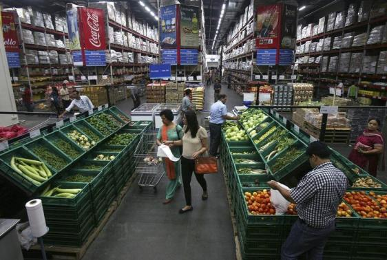 Customers shop at a Best Price Modern Wholesale store, a joint venture of Wal-Mart Stores Inc and Bharti Enterprises, at Zirakpur