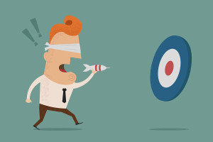Businessman trying to hit a target with darts Vector art and illustration