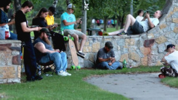 Gamers gather at Gregory Park to play the popular new game Pokemon Go Friday in Brainerd. Pokemon Go is an augmented reality cell phone game which uses real life locations like the park as the basis of the game. (Kelly Humphrey, Brainerd Dispatch)