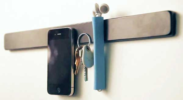 TidyTilt for iPhone, on magnetic key holder