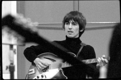 George Harrison, with Rickenbacker guitar