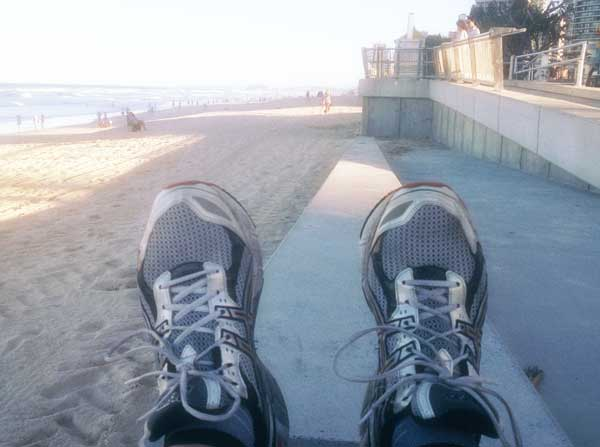 Scott training for the Gold Coast Marathon. Or stops, lays down and takes a photo of his shoes, with the race turnaround point in the background.