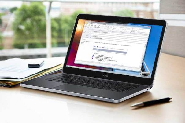 Dell XPS 14 laptop, lifestyle shot on desk
