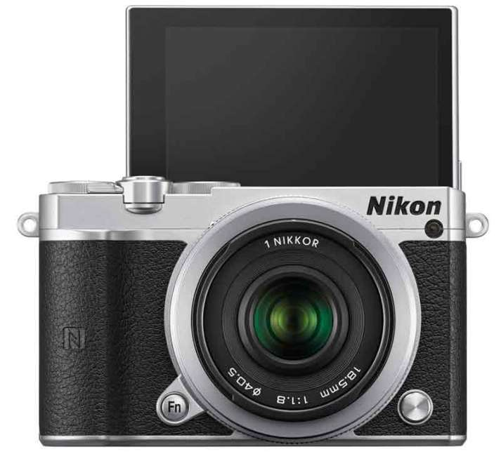 Nikon 1 J5 mirrorless camera black, front view with flip screen