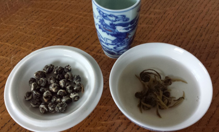 Leaf, liquor, and infusion of Silver Dragon Jasmine Pearls from SevenCups.com