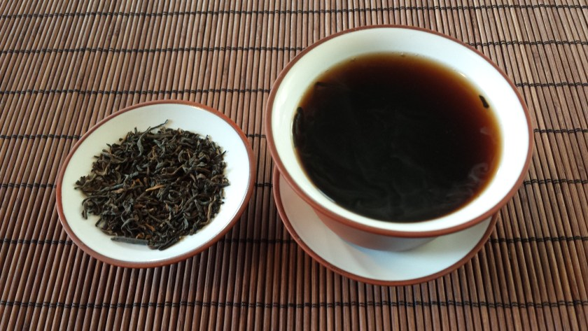 dry leaf and liquor of Gong Ting Palace Puer 2008 from SevenCups.com