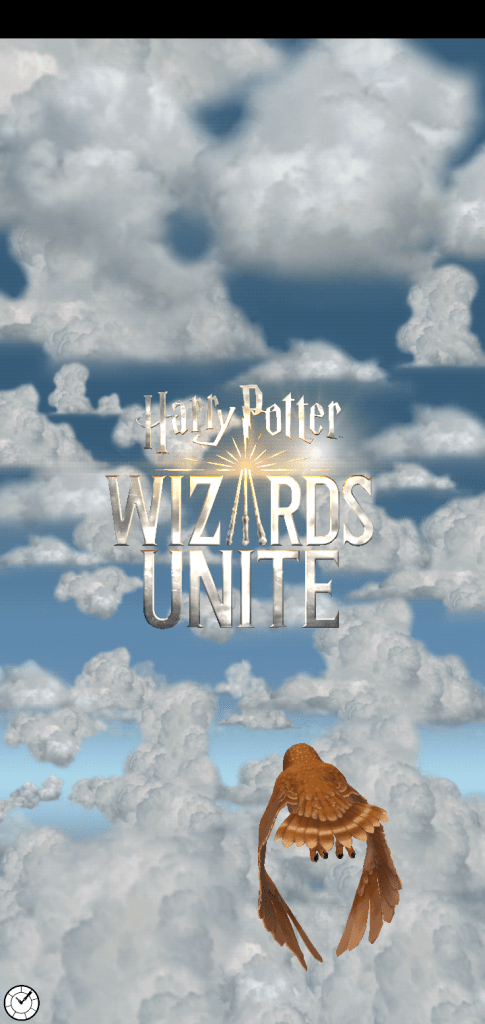A screenshot from the game Harry Potter Wizards Unite, an image of an owl flying toward the game's title