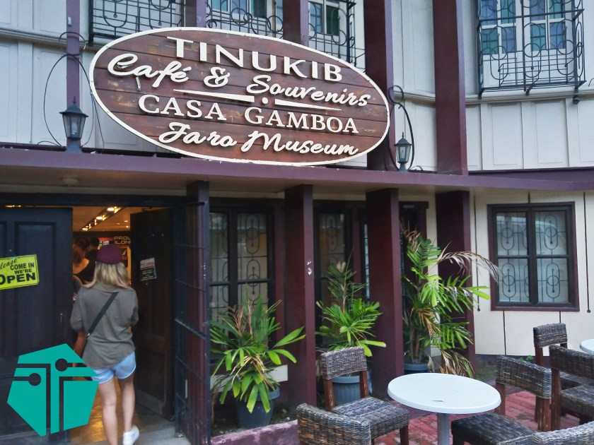 A photo of the Tinukib Cafe and Souvenirs facade with a lady entering the door. This Photo was taken during our Capture Capiz and Iloilo Tour.